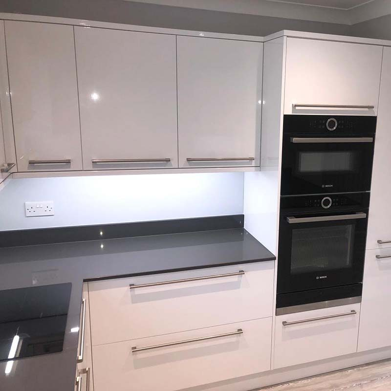 New white and black kitchen install with bright lights